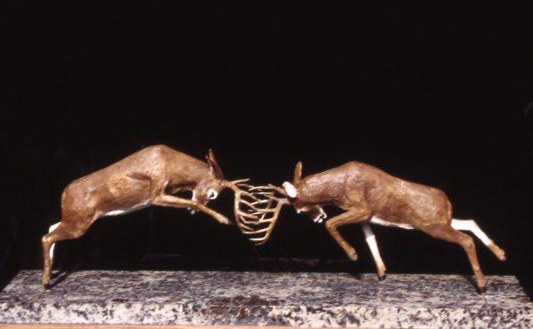 """Buck Battle"" - Whitetail Deer by Jim Gartin 20"" x 6""x 10H"" - 25lbs - L/E -30 Bronze on Adirondack Garnet Stone"