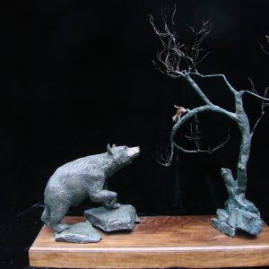 """The Scolding"" By James Carlson Gartin 21"" x 8"" x 21""H - L/E 25 - Bronze Walking through the woods, have you ever been scolded by a little red squirrel in a tree?"
