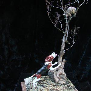 """Treed Coon"" 10"" x 10"" x 22""H L/E 30 Bronze on Adirondack Garnet Stone"