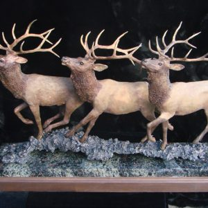 "'Wapiti on the Run"" by Jim Gartin 30"" x 8"" x 17""H - L/E - 30 Bronze on Garnet Stone"