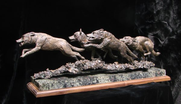 """Wolves on the Chase"" by Jim Gartin 24"" x 5"" x 8""H - 50lbs - L/E - 30 Bronze on Adirondack Garnet Stone"